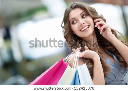 Attractive young girl talking on the phone