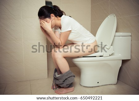 Attractive Young Girl Waking Up At Morning Sitting On Bathroom Toilet And Feeling Tired Showing Daily