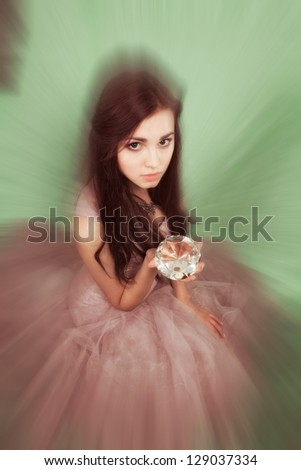 Attractive young girl with a big diamond