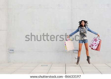 Attractive young girl with shopping bags in the street