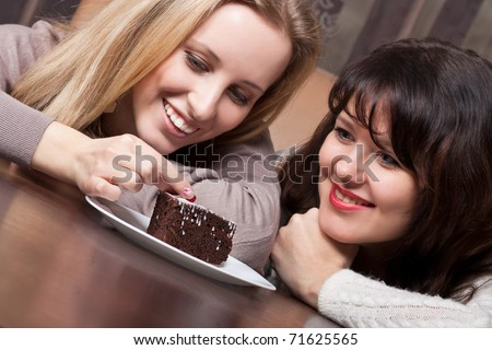 Attractive young girls with a pie