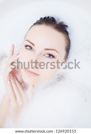 Attractive young gorgeous women taking bath - stock photo