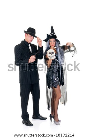 Attractive young Halloween couple, mafia suit and witch costume.    Studio shot, white background.