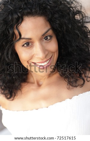 Attractive young hispanic female smiling