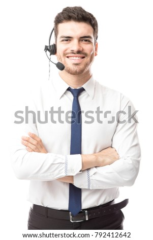 Attractive young Hispanic sutomer support tech working in a call center with a smile #792412642