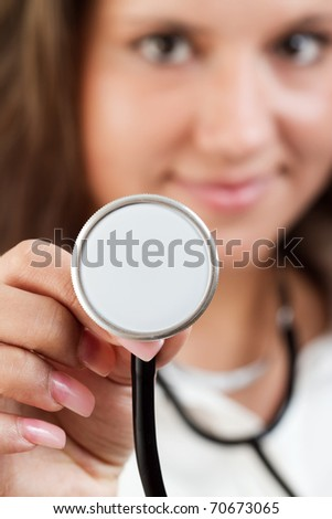 Attractive young lady doctor with stethoscope over a white background