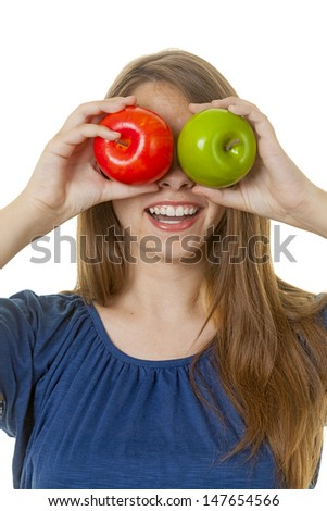 Attractive young lady with green and red apples