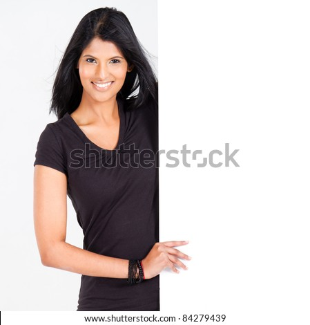 attractive young latin woman presenting white board