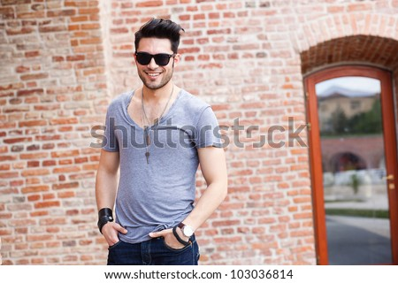 attractive young male model smiling