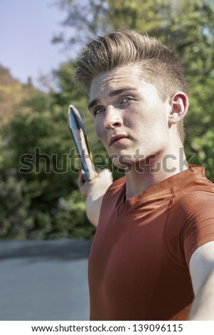 Attractive young man concentrates to throw his metallic  javelin