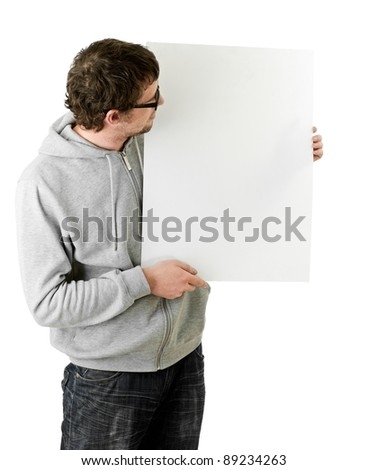 Attractive young man holding blank sign. All on white background.