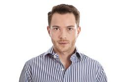 Attractive young man in blue shirt staring at camera