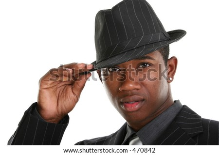 Attractive Young Man In Pin Striped Suit and Hat.  Shot in studio over white.