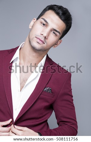 21f8ef4535 Attractive young man in white shirt and maroon suits studio shot, male  model on dark