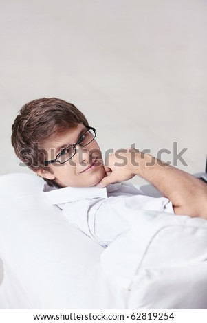 Attractive young man on the couch