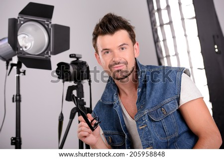 Attractive young man photographer at work in his studio