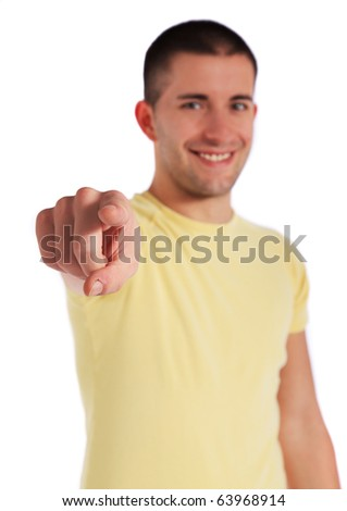 Attractive young man pointing with finger. All on white background.