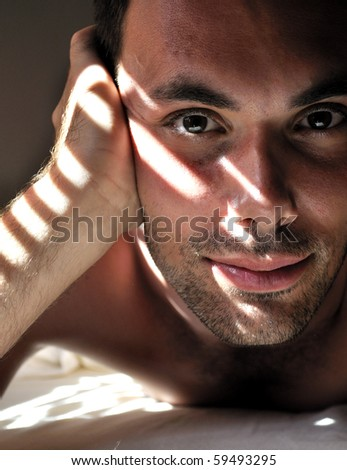 Attractive young man portrait in special lightening