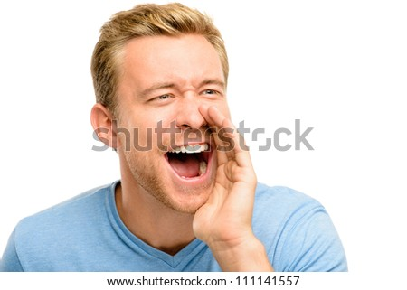 Attractive young man shouting - isolated on white background