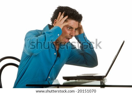 Attractive young man upset after a computer crash