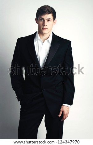 Attractive Young Man wearing a tuxedo, casually unbuttoned.