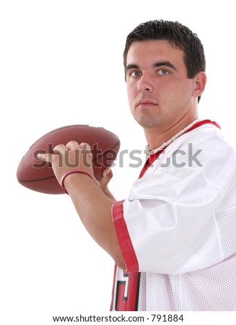Attractive young man with football.  Wearing red and white football jersey.