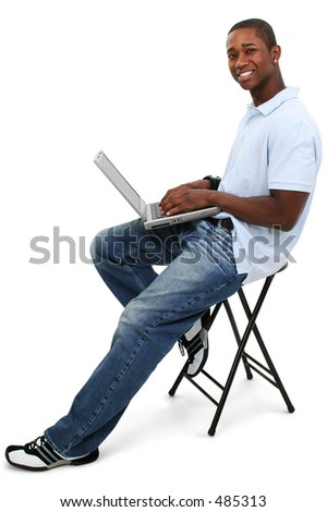 Attractive Young Man With Laptop Computer.  Shot in studio over white.