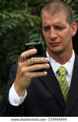 Attractive, Young Mature Professional Businessman Man Confused While on a Phone Call and Texting (Funny)