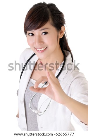 Attractive young medical doctor woman give ok gesture with smiling.