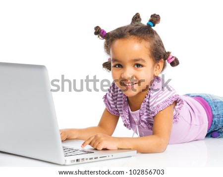 Attractive young mulatto girl using notebook computer. Isolated on white background.