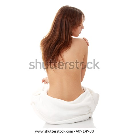 Attractive young nude woman getting ready for spa treatment, isolated on white