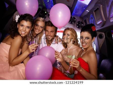 Attractive young people having party in limousine. - stock photo