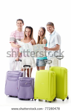 Attractive young people with suitcases and map isolated