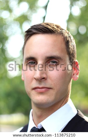 Attractive, Young Professional Business Man Who is  Mature and Serious