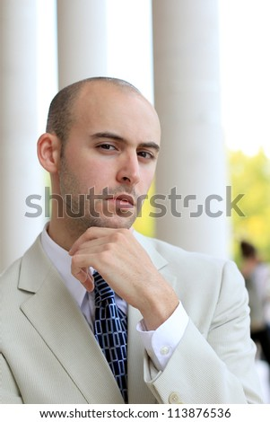 Attractive, Young Professional Mature Businessman Man Thinking and Concerned