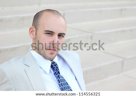 Attractive, Young Professional Serious and Mature Businessman Man Looking at the Camera
