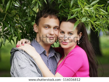 Attractive young romantic couple in the park.