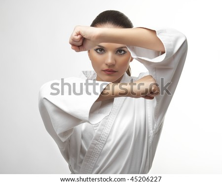 stock photo attractive young sexy women in a karate pose isolated on white 45206227 ... before our eyes (36 Photos)   young actresses turned sexy women 32 ...