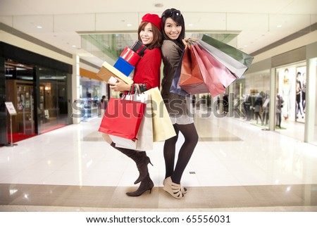attractive young sister go shopping in the mall