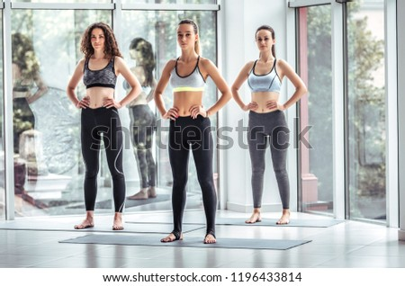 Attractive young sport girls are doing yoga together. Group training. Healthy lifestyle concept. #1196433814