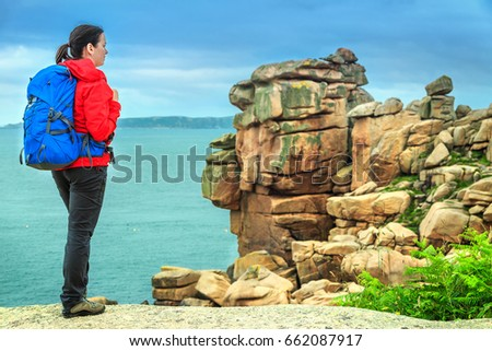Shutterstock Attractive young sportive hiker woman in nature, Perros Guirec, Brittany region, France, Europe