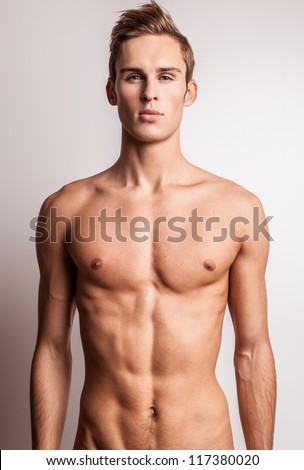 Attractive young undressed man model.