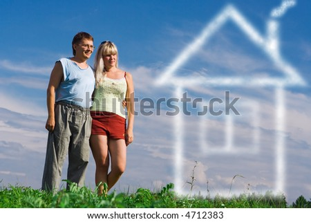 attractive young woman and her handsome boyfiend dream about house