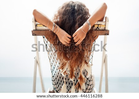 attractive young woman chilling in chair at sea shore. Day off concept #446116288