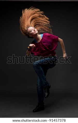 attractive young woman dancing