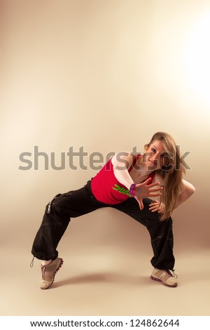 Attractive young woman doing aerobics zumba fitness in studio
