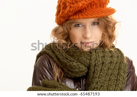 Attractive young woman dressed up warm for winter, wearing hat, gloves, scarf and coat, freezing.?