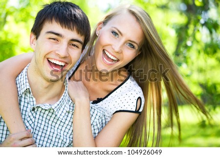 Attractive young woman embracing her handsome boyfrend