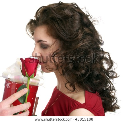 Attractive young woman get a gift with red rose isolated on the white background