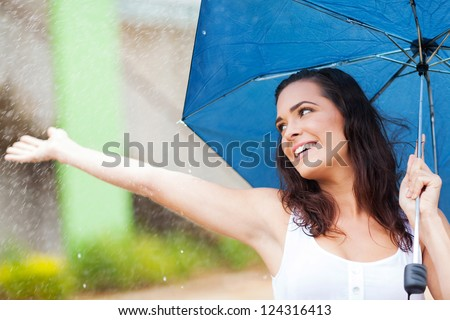 attractive young woman having fun in the rain